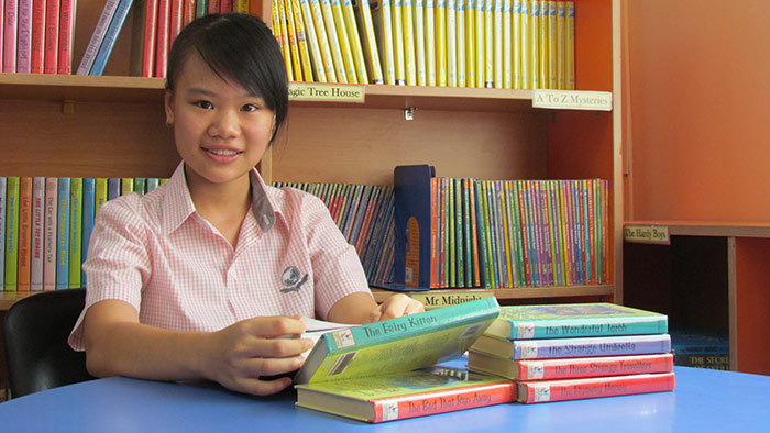 SIS student in library